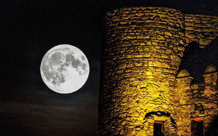 full moon rises by Cassis castle in France