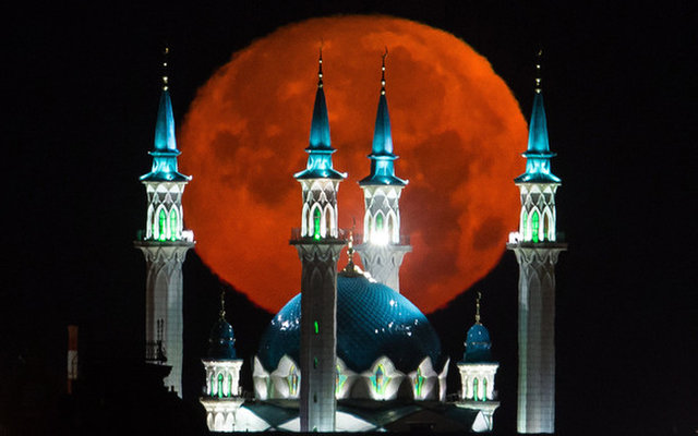 full moon sets over Qolsärif mosque in Russia